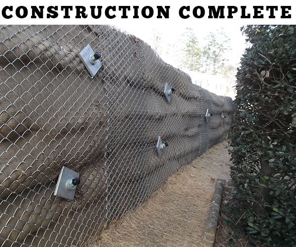 Railroad tie retaining wall repair - construction complete